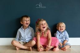three siblings at home