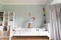 boy playing on the bed