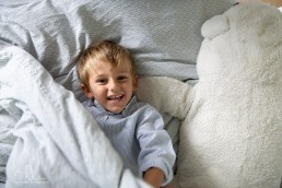boy playing in bed