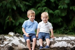 brothers sitting on a log
