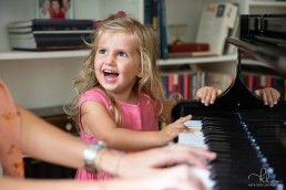 young girl with mum on the piano