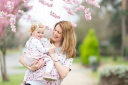 Mum and daughter in the blossom trees